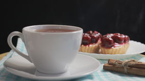 Hot tea and cherry dessert. Delicious breakfast stock video footage