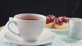 Hot tea and cherry dessert. Delicious breakfast stock footage