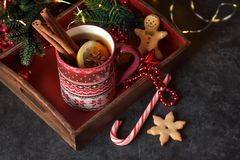 Hot tea with christmas decoration royalty free stock image