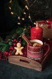 Hot tea with christmas decoration. Christmas hot tea with lemon and cinnamon at the table with christmas decoration stock images