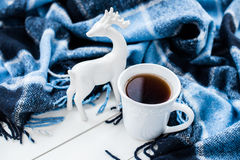 Hot tea and Christmas deer Royalty Free Stock Images
