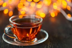 Hot tea in Christmas in a glass transparent Cup with tea Royalty Free Stock Images