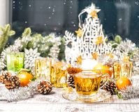 Hot tea Christmas window decoration Winter food drinks. Hot tea with Christmas window decoration. Winter food and drinks Royalty Free Stock Images