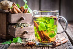 Hot tea with cinnamon and cloves Royalty Free Stock Photos