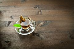 Hot tea and cinnamon in the cup Stock Images