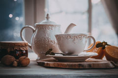 Hot tea in cold winter. Evening. Dark photo Royalty Free Stock Photo