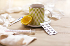 Hot tea for colds, pills  handkerchiefs and thermometer Stock Photography