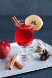Hot tea with cranberries, apple and cinnamon spices Royalty Free Stock Image
