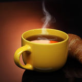 Hot tea and croissant Royalty Free Stock Images