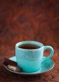 Hot tea cup. A cup of hot tea and chocolates, selective focus stock photos