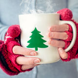 Hot tea cup. Woman holding tea cup at christmas royalty free stock images