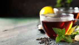 Hot tea cup with mint and sugar Stock Photo