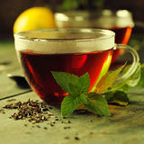 Hot tea cup with mint and sugar Stock Image