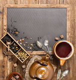 Hot tea in a cup and teapot, overhead view Royalty Free Stock Image