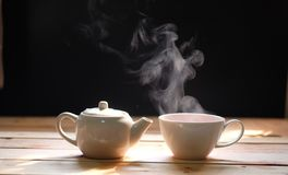 Hot tea cup on wood background.Hot drink. stock image