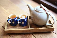 The hot tea in the cups, as wood background. Or print card Royalty Free Stock Photo