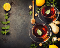 Hot tea cups with mint, lemon and sugar Stock Photos