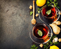 Hot tea cups with mint, lemon and sugar Royalty Free Stock Photography