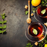 Hot tea cups with mint, lemon and sugar Stock Photography