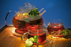 Hot tea with curative herbs in teapot and cups Royalty Free Stock Photography