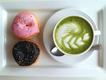 Hot tea so delicious with donut on white. Matcha latte so delicious with donut on white Stock Image