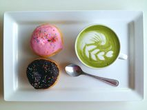 Hot tea so delicious with donut on white. Matcha latte so delicious with donut on white Royalty Free Stock Photography