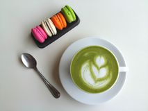 Hot tea so delicious with macaroon on white. Matcha latte so delicious with macaroon on white Royalty Free Stock Image