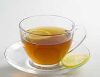 Hot tea drink with lemon stock images
