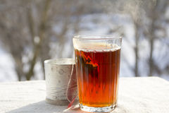 Hot tea in a faceted glass Stock Photography