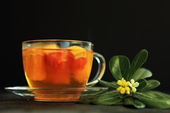 Hot tea with a flower Stock Photos