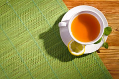 Hot tea with fresh leves and lemon Stock Image