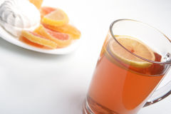 Hot tea with fruit candy Royalty Free Stock Images