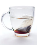 Hot tea in glass cup. Freshly brewed tea with a tea bag in a glass mug Royalty Free Stock Images