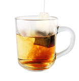 Hot tea in glass mug with packet Stock Photography