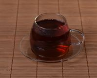 Hot tea in a glass teacup Royalty Free Stock Image