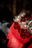 Hot tea in glasses. Hot turkish tea (Çai) served in small glasses, placed on a red tablecloth, near Antalya (Turkey Royalty Free Stock Images
