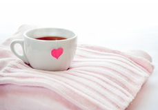 Hot tea with heart teabag Stock Image