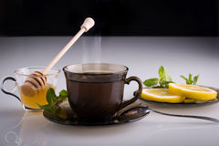 Hot tea. With honey, mint and lemon slices Royalty Free Stock Images