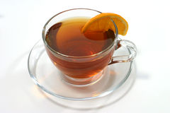 Hot tea inside transparent glass and lemon slice Stock Photo