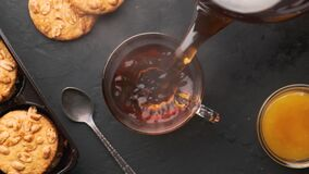 Free Hot Tea Is Poured Into A Cup And Slowly Emits Steam Royalty Free Stock Photos - 180777438