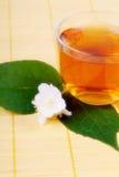 Hot tea and jasmine Royalty Free Stock Photo