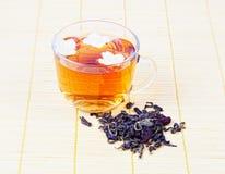 Hot tea with a jasmine flower Stock Photos