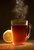 Hot tea with a lemon. Hot classical tea and yellow lemon Royalty Free Stock Image