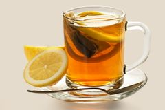 Hot tea with a lemon Stock Photo