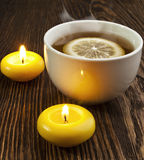 Hot tea with lemon. And evaporation on a wooden table Royalty Free Stock Images
