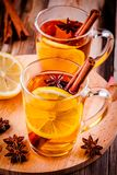 Hot tea with lemon, anise and cinnamon in glass mugs Royalty Free Stock Images