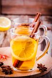Hot tea with lemon, anise and cinnamon in glass mugs Royalty Free Stock Photography