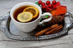 Hot tea with lemon in autumn and winter evenings - a festive table Stock Images