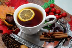 Hot tea with lemon in autumn and winter evenings - a festive table Royalty Free Stock Image