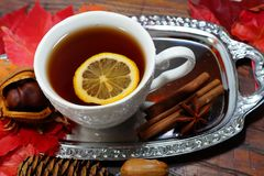 Hot tea with lemon in autumn and winter evenings - a festive table Royalty Free Stock Photos